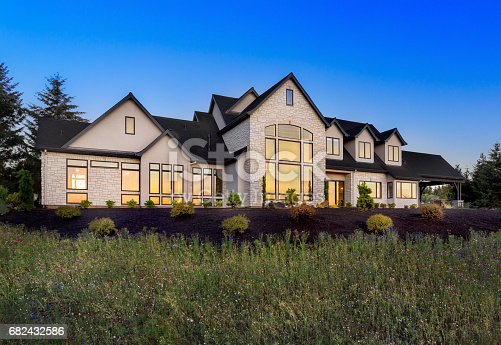 istock Beautiful Home Exterior at Night: Large Expansive and Stately Home 682432586