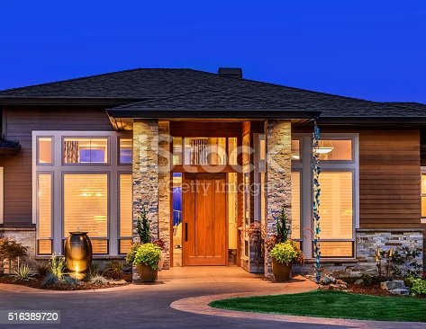697393252 istock photo Beautiful Home Exterior at Night 516389720