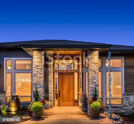 697393252 istock photo Beautiful Home Exterior at Night 516389762