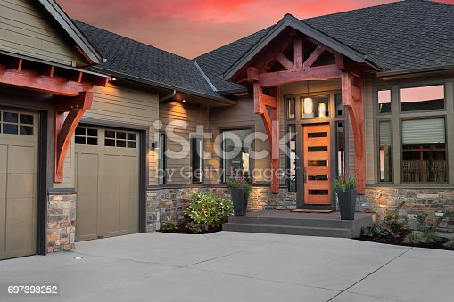 697393252 istock photo Beautiful Home Exterior Detail with Colorful Sunset: Front Door,Entrance, and Garage 697393252