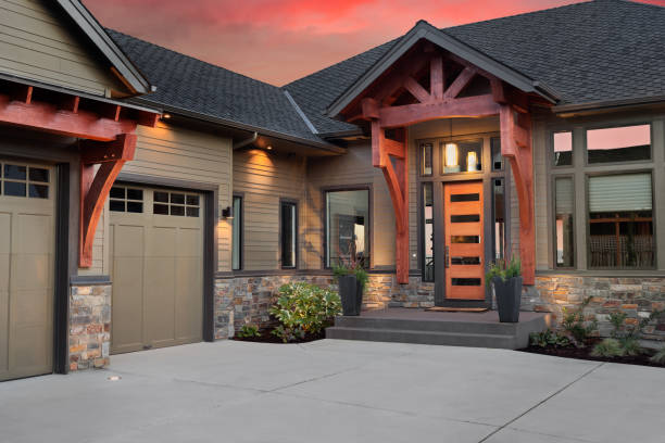 Beautiful Home Exterior Detail with Colorful Sunset: Front Door,Entrance, and Garage stock photo