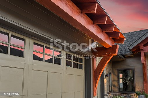 697393252 istock photo Beautiful Home Exterior Detail with Colorful Sunset: Garage and Front Exterior 697393254