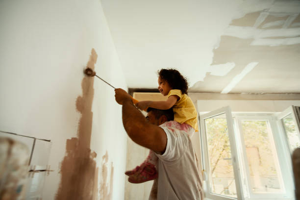 Beautiful home for beautiful family Young family renovating their home, painting wall home improvement stock pictures, royalty-free photos & images