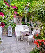 Beautiful home garden in antique yard on a sunny summer day.