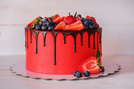 istock beautiful home made red cake with strawberries and blueberries 953456556