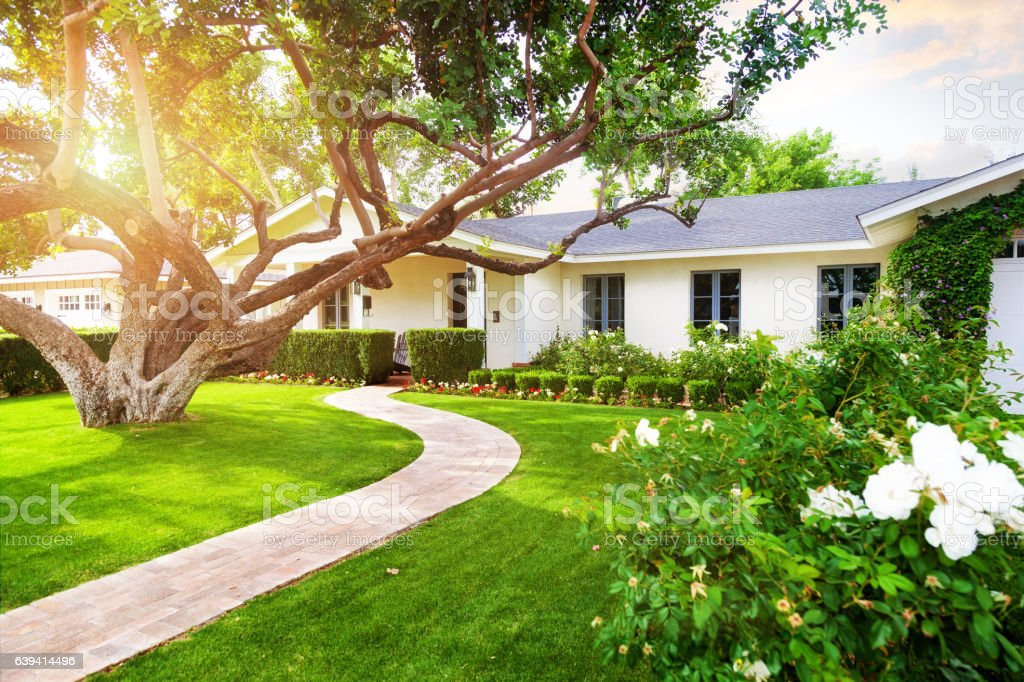 Beautiful Home With Green Grass Yard stock photo
