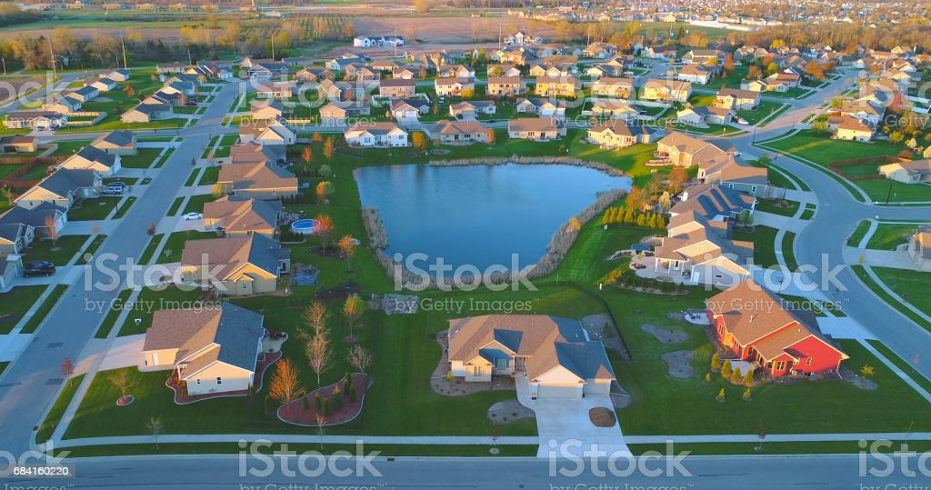 Beautiful homes around pond, aerial view, Springtime dawn. stock photo