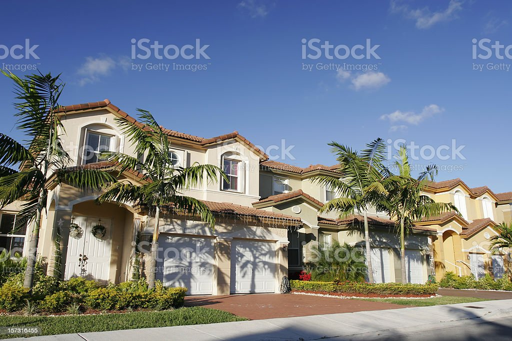 A beautiful house for a single family with palm trees stock photo