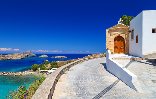 istock beautiful house in Lindos on background bay, yachts and ships 601000644