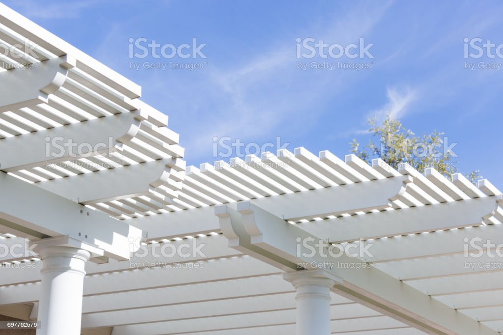 Beautiful House Patio Cover Against the Blue Sky. stock photo