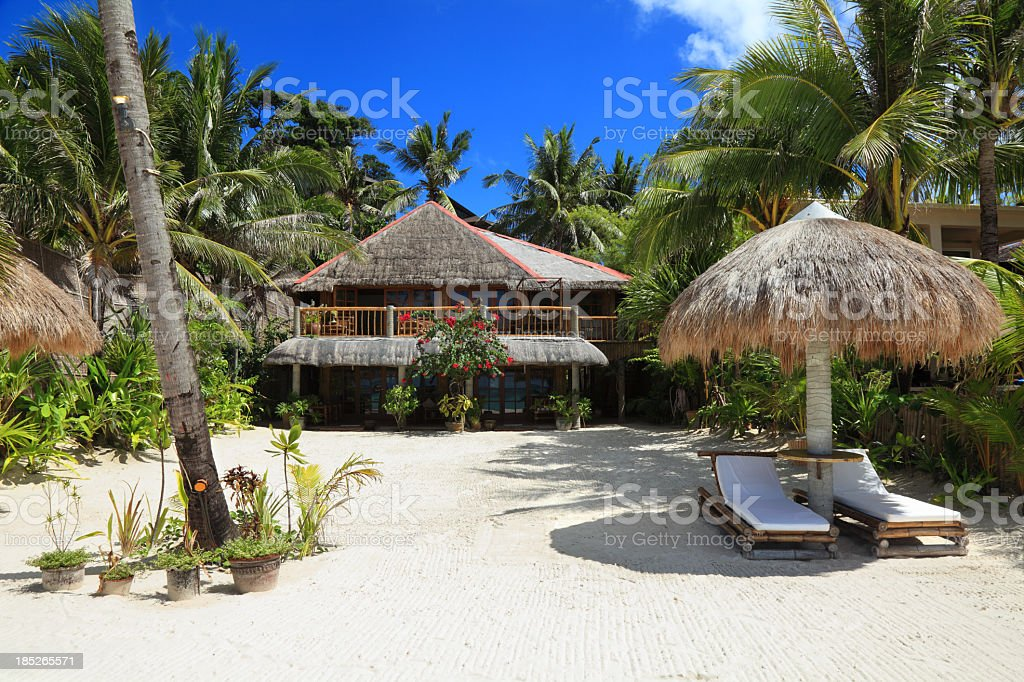 Beautiful house with garden on the beach royalty-free stock photo