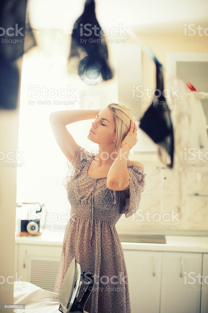 Beautiful housewife doing home jobs stock photo