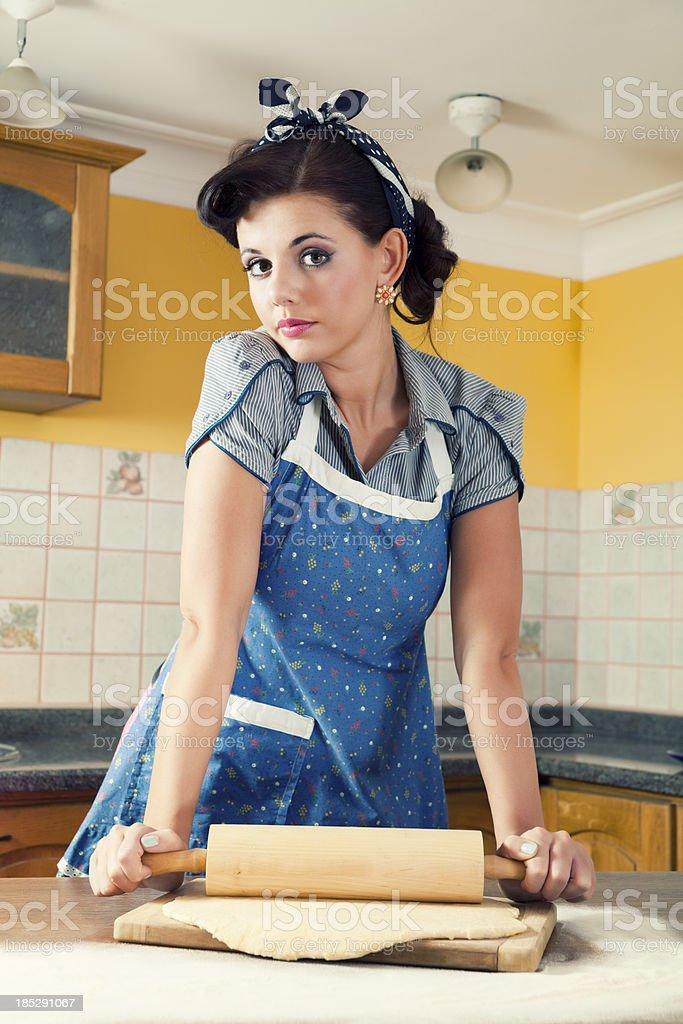 Beautiful Housewife Rolling Dough royalty-free stock photo