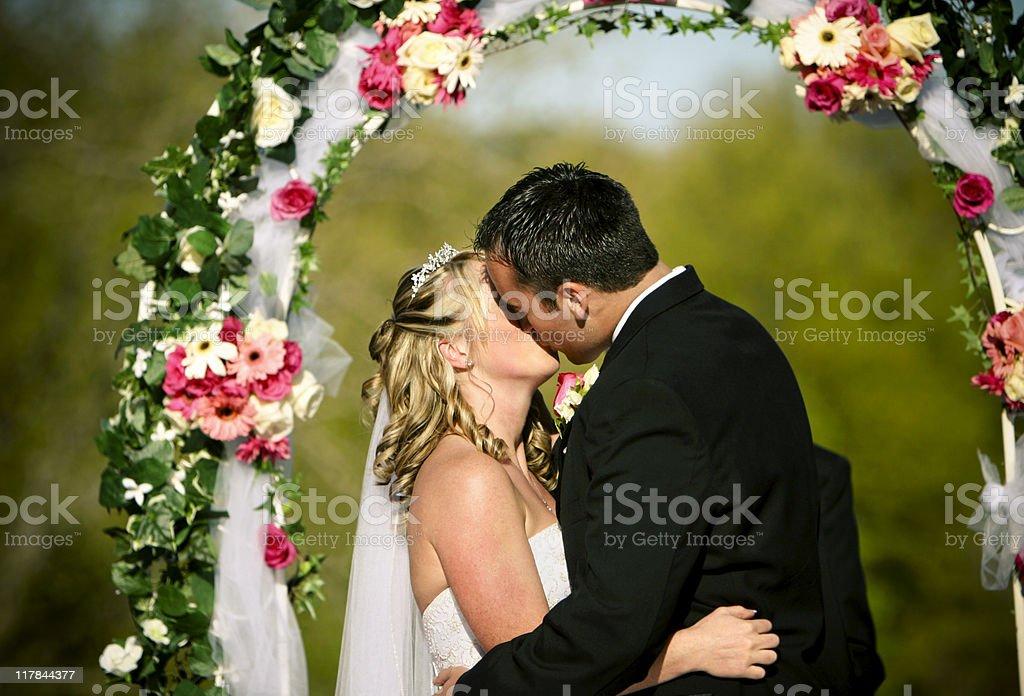 Beautiful Husband and Wife Kiss royalty-free stock photo