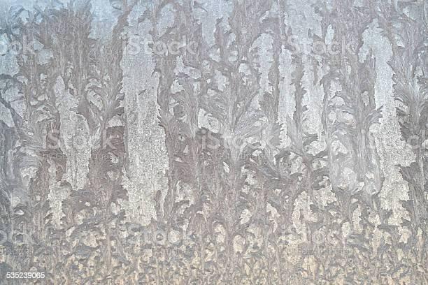 Photo of Beautiful ice floral pattern on glass, holiday seasonal background