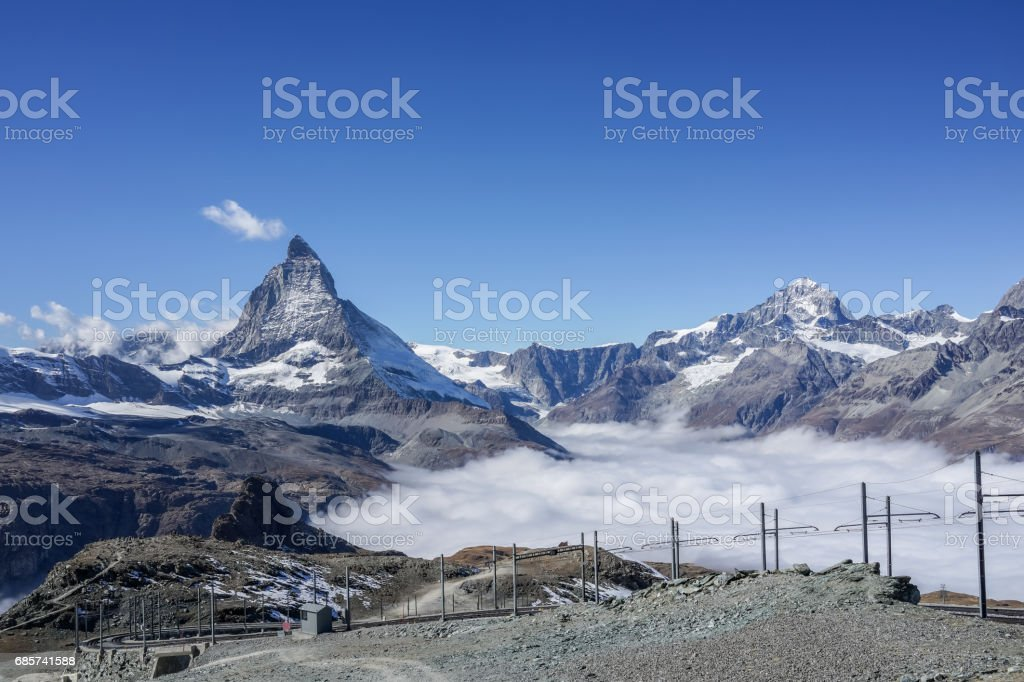 Beautiful iconic mountain Matterhorn with clear blue sky and mist below, Zermatt, Switzerland stock photo