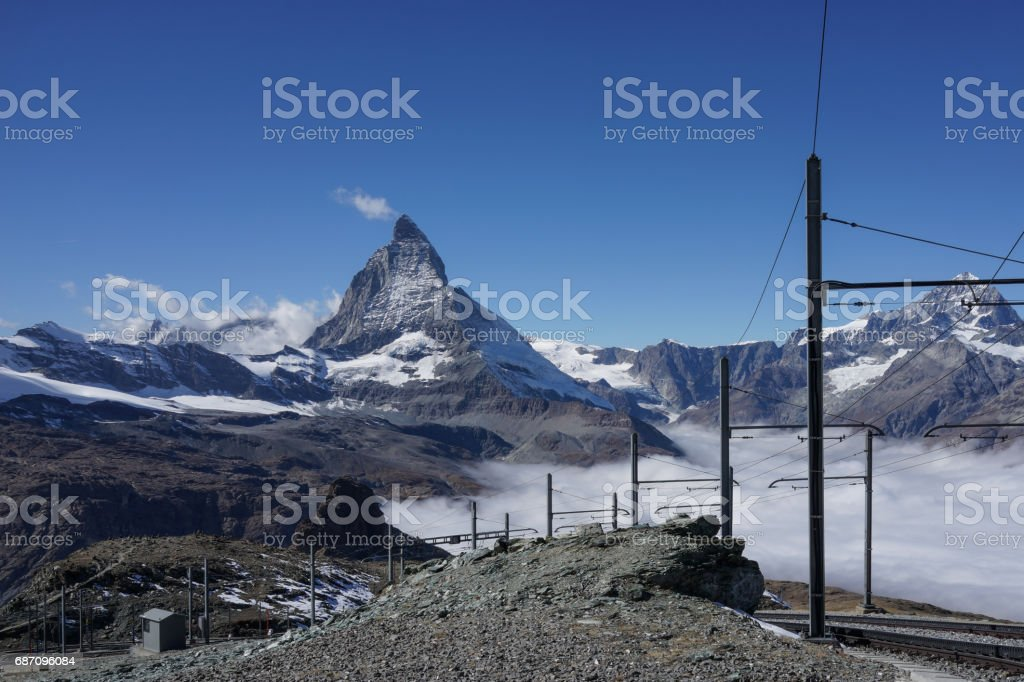 Beautiful iconic mountain Matterhorn with with railway and mist below Zermatt, Switzerland stock photo