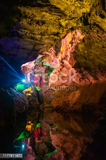 Beautiful illuminated multicolored stalactites in Danzhou Stone Flower Caves, Geopark next to Haikou in Hainan, China