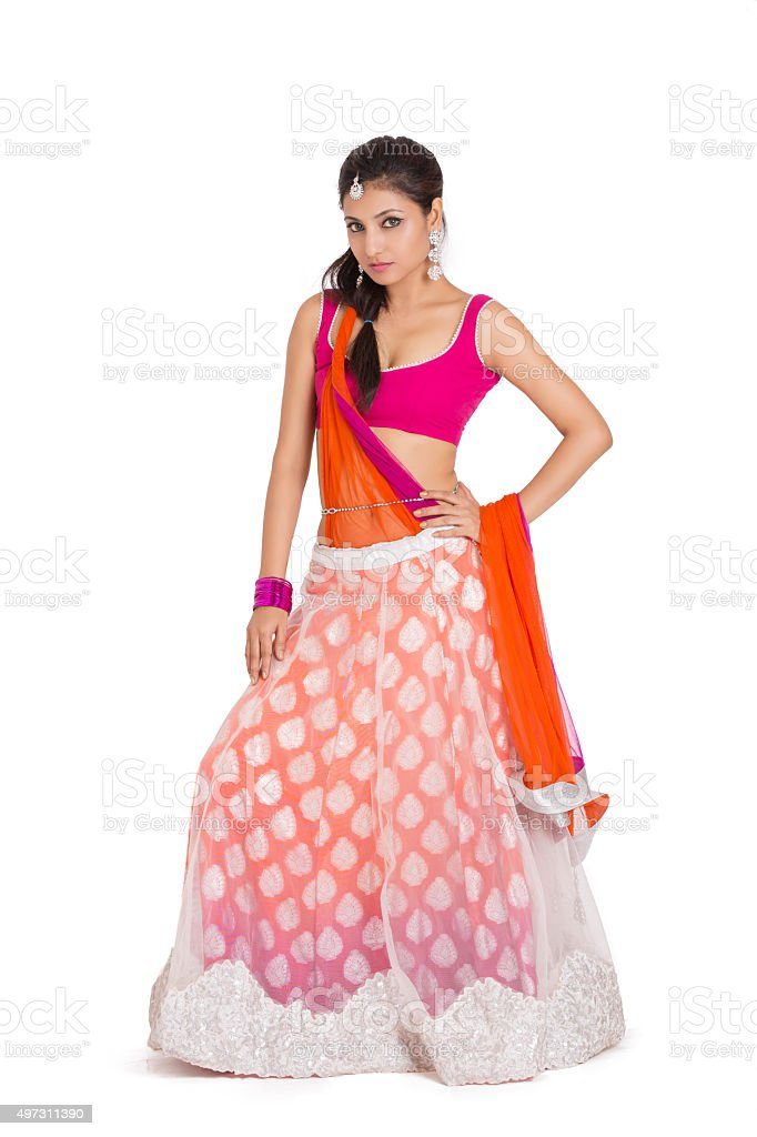 Beautiful Indian bride in colorful dress stock photo