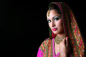 istock A beautiful Indian bride in colorful traditional dress 172375748