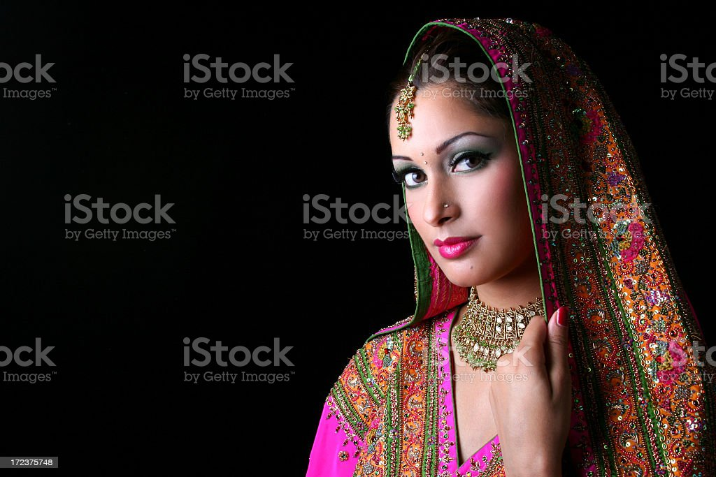A beautiful Indian bride in colorful traditional dress stock photo