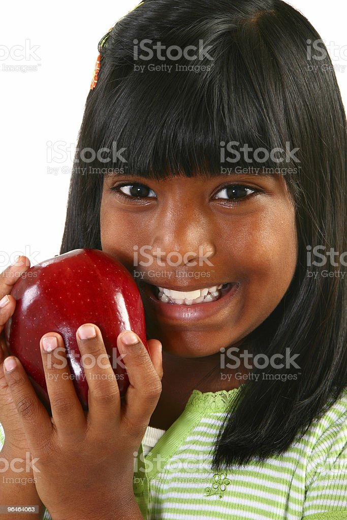 Beautiful Indian Girl with Apple royalty-free stock photo