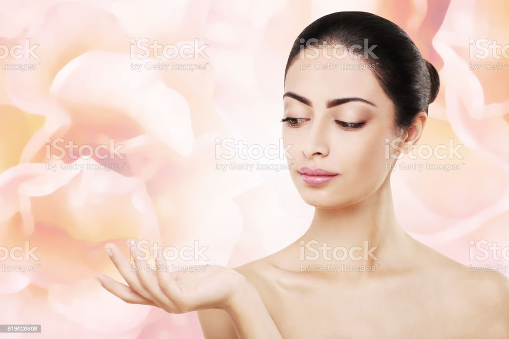 Beautiful indian girl with perfect skin, isolated on pink background stock photo