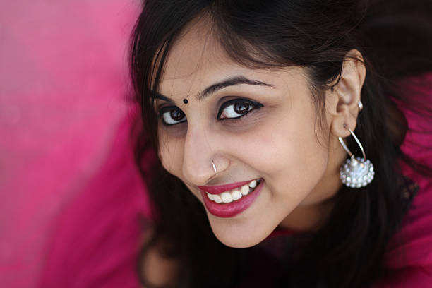 beautiful indian woman smiling at camera. - nose ring stock pictures, royalty-free photos & images