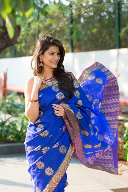 beautiful Indian woman wearing saree stock photo