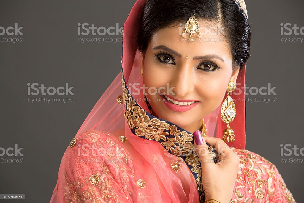 Beautiful Indian women portrait with jewelry stock photo