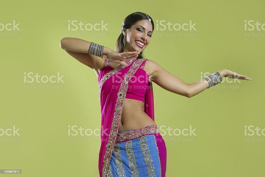 Beautiful indian young brunette woman dancing stock photo
