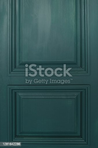 beautiful wooden door in indigo color, painted with paint, interesting interior solution, element of architecture and design, bright and unusual color, background for text, blank with free space