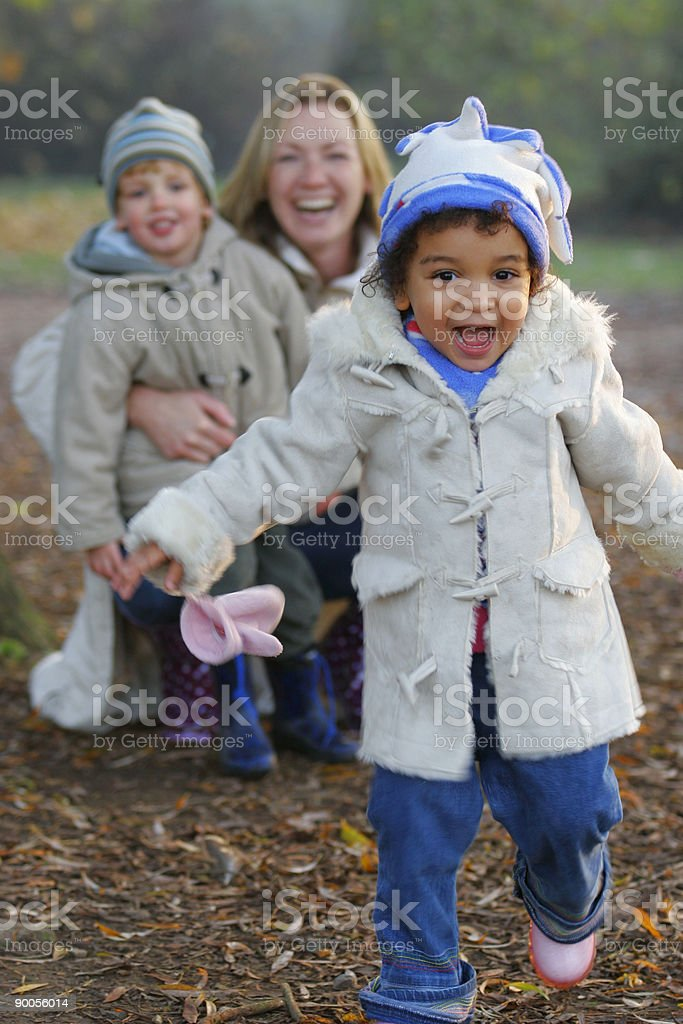 Beautiful Interracial African American Girl Laughing With Mother and Boy royalty-free stock photo