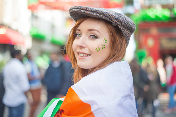 beautiful irish girl on st. patricks day, dublin, ireland. - st patricks day stock photos and pictures