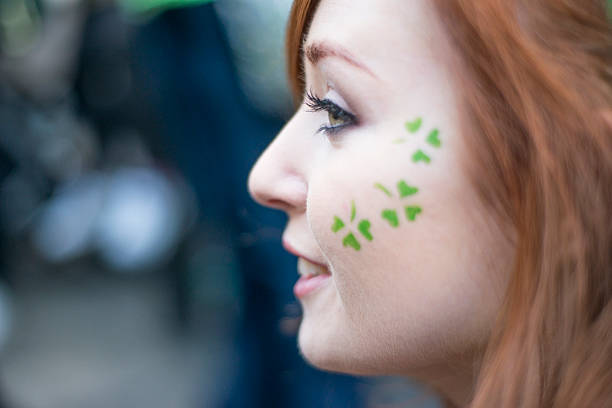 beautiful irish girl on st. patricks day, dublin, ireland. - woman green eyes red hair stock photos and pictures