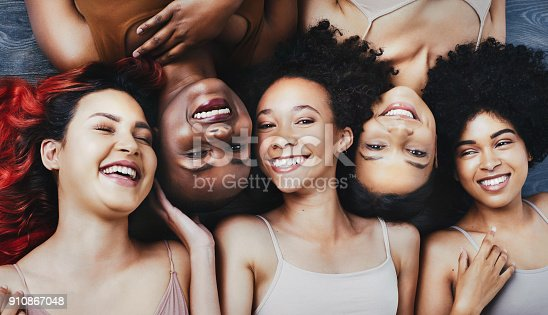 High angle shot of a group of beautiful young women lying next to each other