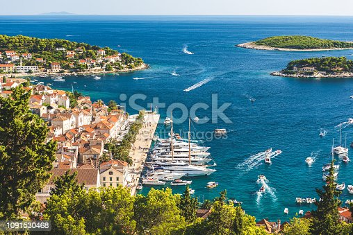 Beautiful old town of Hvar looking at the pier and bay of water of the Adriatic Sea