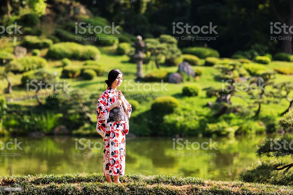 Beautiful japanese woman in the park stock photo