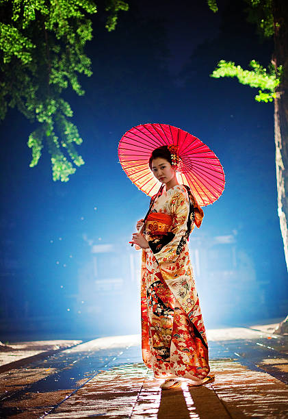 beautiful japanese woman with kimono in tokyo, japan - geisha girl stock photos and pictures