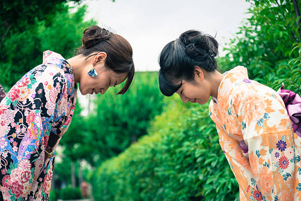Beautiful Japanese Women in Kimono Bowing, Kyoto, Japan stock photo