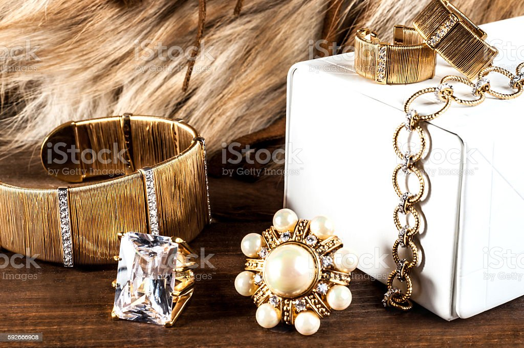 beautiful jewelry made of gold and precious stones stock photo