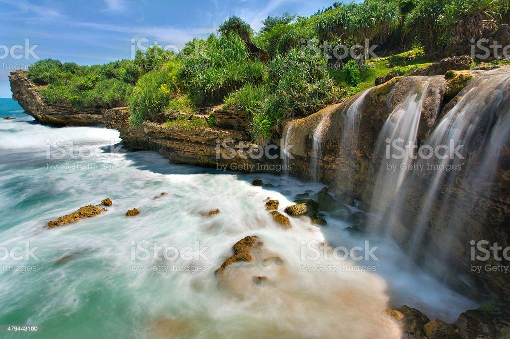 Beautiful Jogan waterfall falling to the ocean stock photo