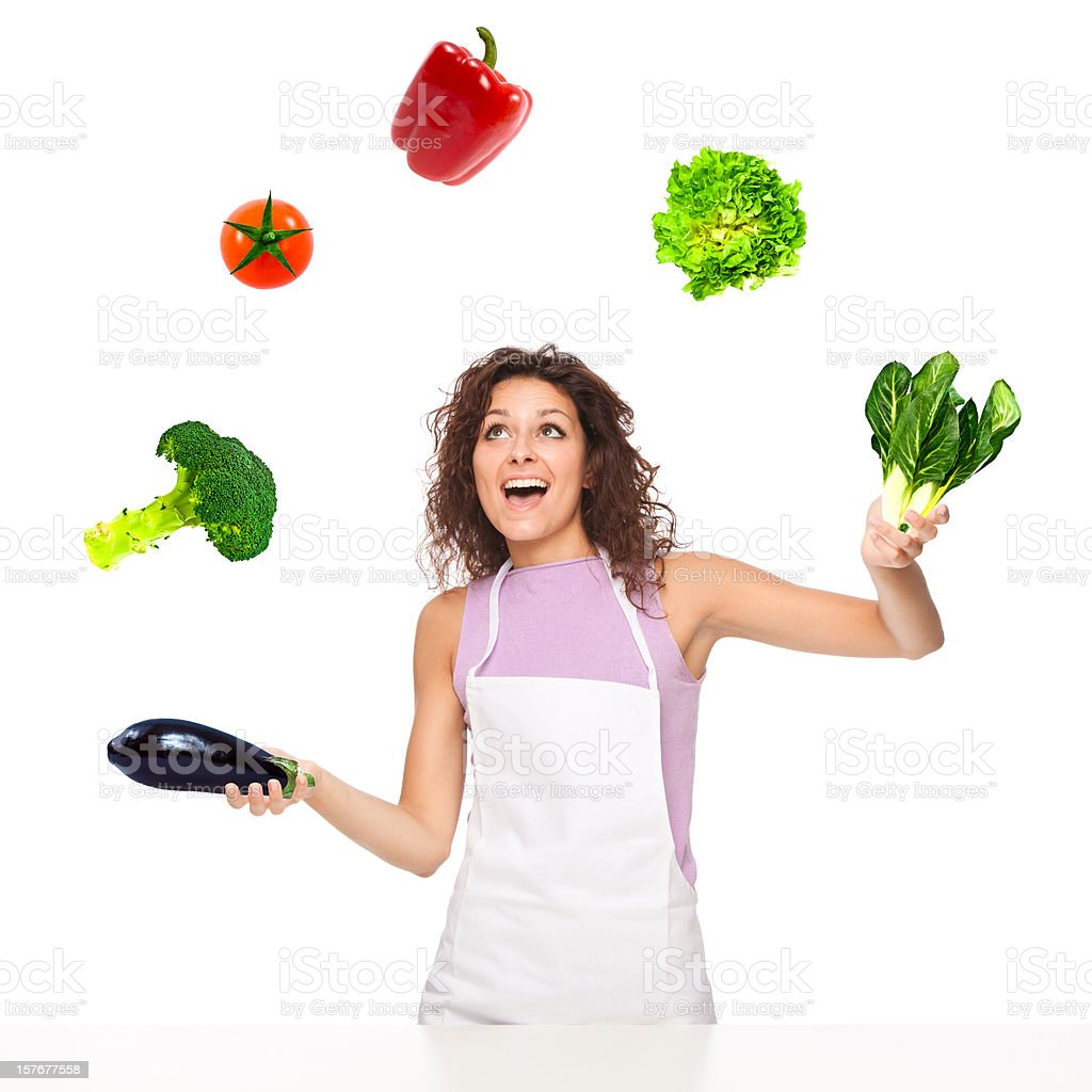beautiful juggler cook girl play with vegetables isolated on whi royalty-free stock photo