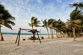 """Beautiful Jumeirah Beach, Dubai, UAE.Wind blowing the palm trees."""