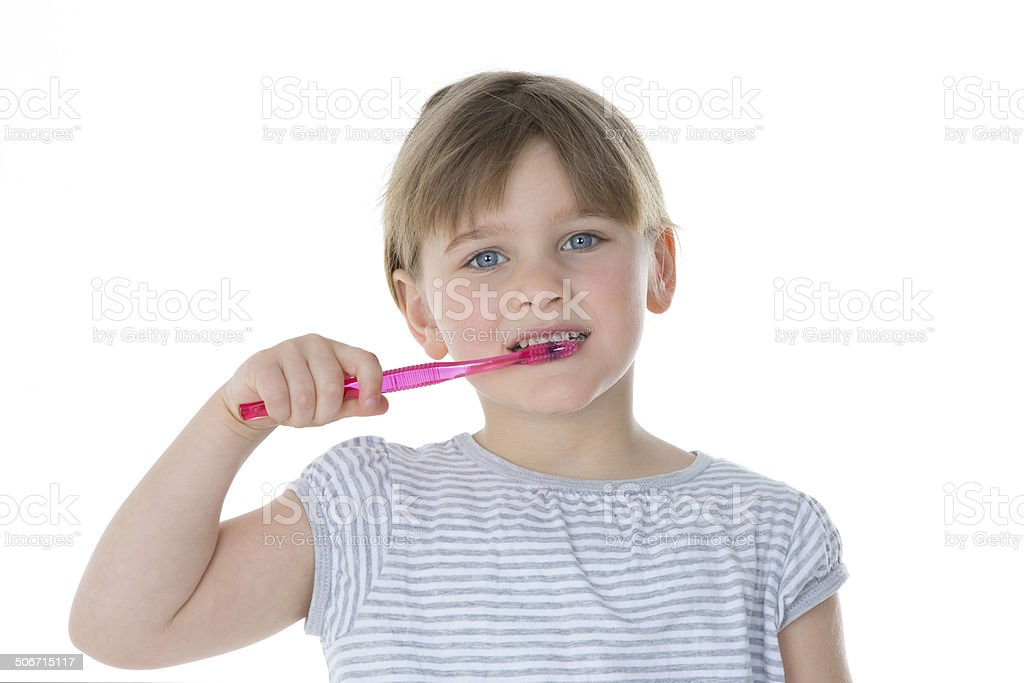 beautiful kid brushes her teeth stock photo