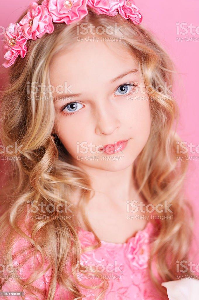 Beautiful kid girl posing over pink stock photo