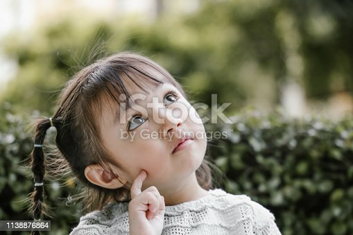 Portrait, pigtails, thinking, planning, positive emotion, Ideas, Inspiration, creativity, studying, learning, garden, nature, Asian and Indian Ethnicities