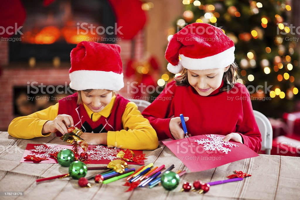 Beautiful kids making Christmas cards. royalty-free stock photo