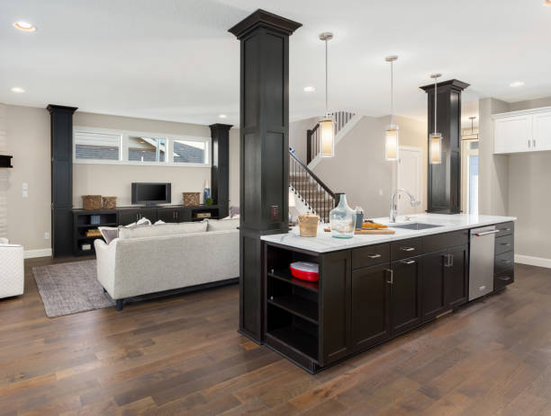 Beautiful kitchen and living room interior with hardwood floors in new home stock photo