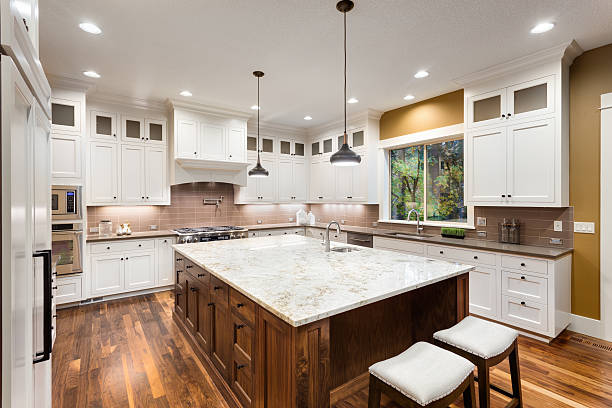 Kitchen And Home Interiors open concept kitchen featuring rutt cabinetry Beautiful Kitchen In Luxury Home Stock Photo